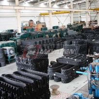 Rubber Tracks Manufacturing Facility - staging of harvester rubber tracks for Kubota Harvesters
